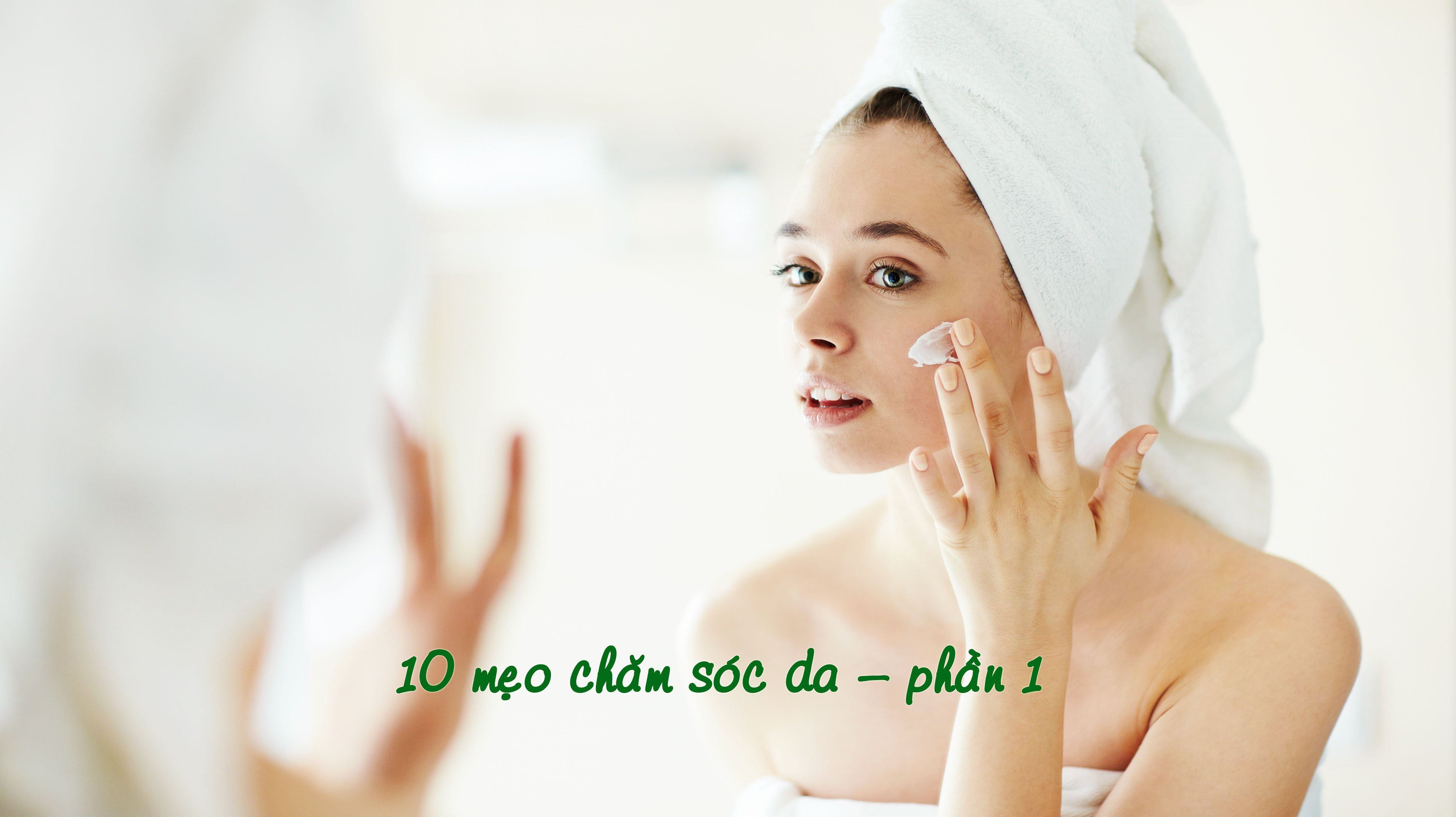 Pretty girl applying moisturizing cream in front of mirror